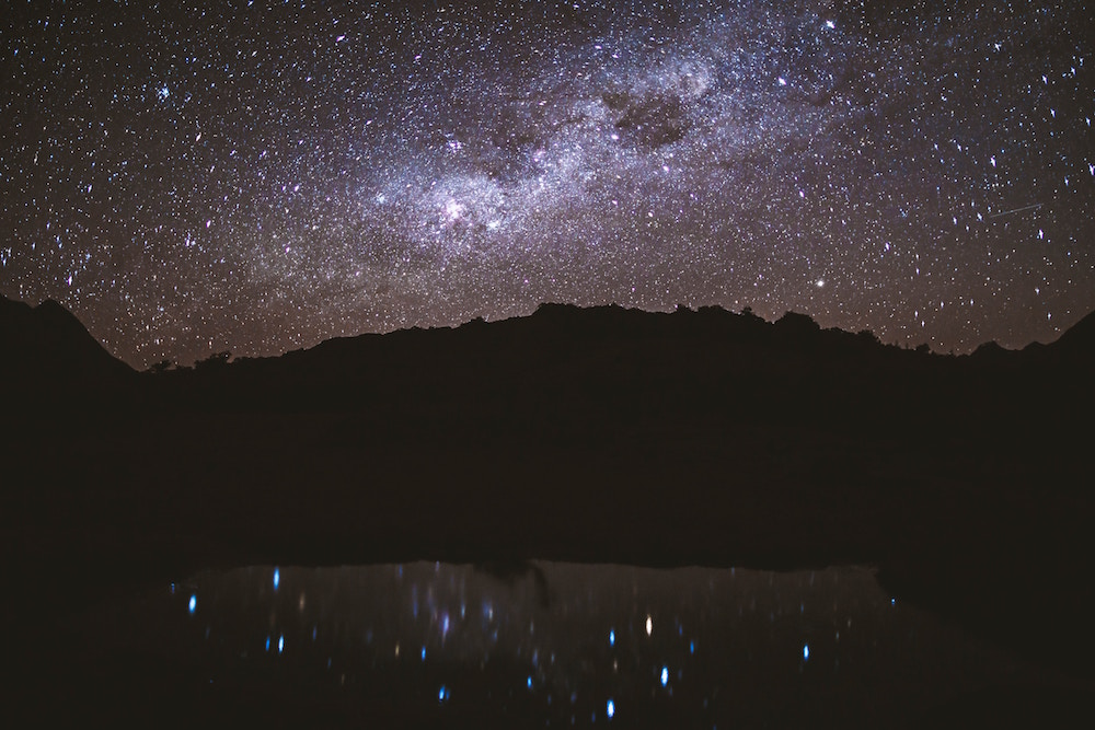 new zealand milky way and stars and dark sky over mountains